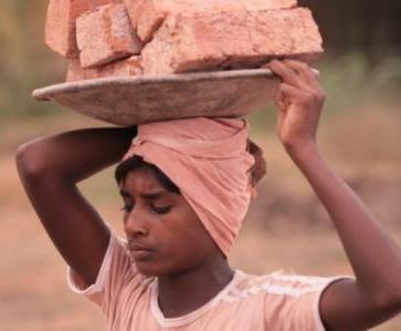 Child working in a Brick Kiln