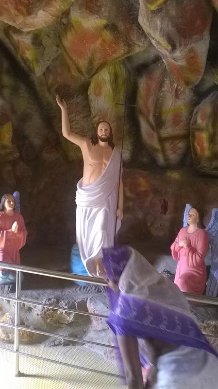 A sculpture view of Jesus with Cross as seen in Pinakadimi, Eluru, A.P, India