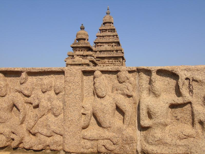 Intricate carvings on stone wall at Shore Temple
