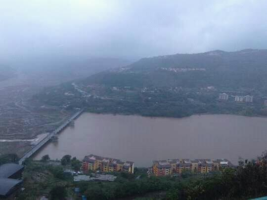 View of beautiful Lavasa City surrounded with black clouds.