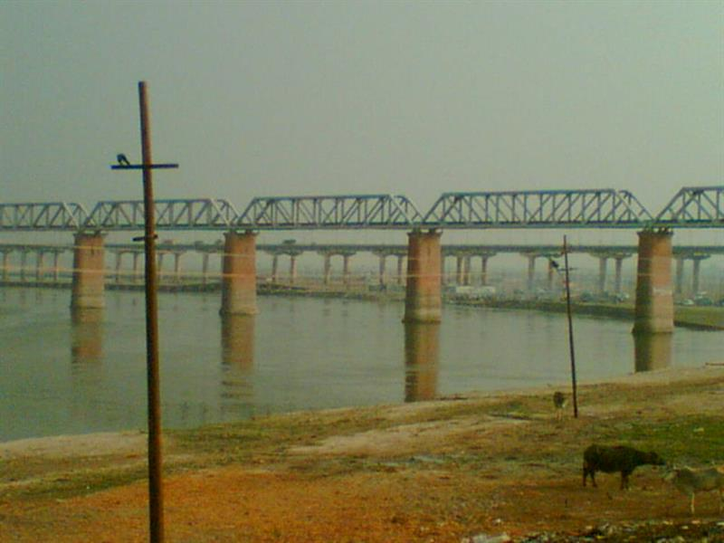 The famous Ganges flowing underneath Allahabad bridge