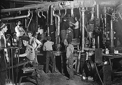 Children working in a factory with adults
