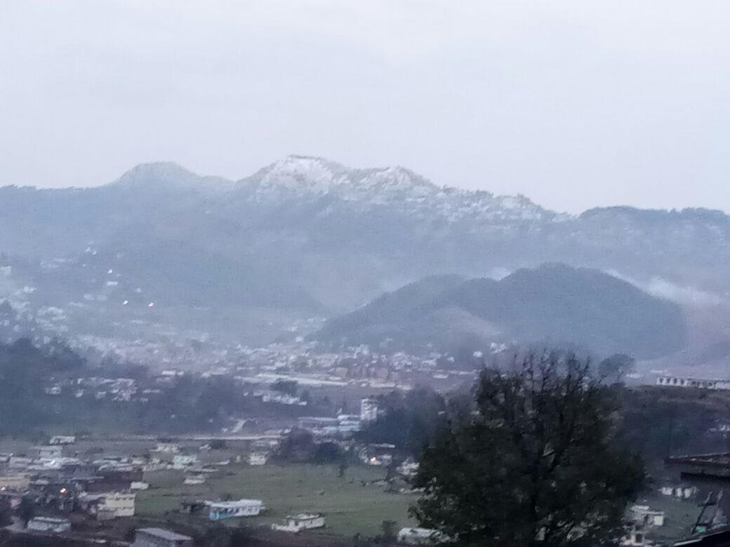 Snow covered hills in the background of Pithoragarh town (Jan18)